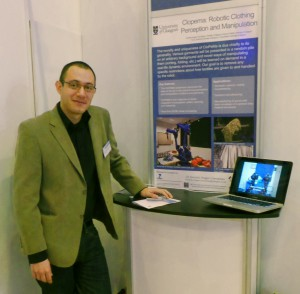 Dr. Gerardo Aragon Camarasa at the CloPeMa stand, SICSA Demofest'13